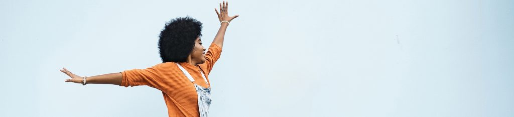 Young Stylish Afro Woman Jumping